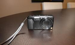 Selling a Panasonic Lumix DMC-ZS30 18 Megapixel 20x optical zoom camera. In excellent condition. This is an excellent camera, and very compact yet powerful. It comes standard with charger adapter,1 battery, strap, CD, box and manual. I am also including a