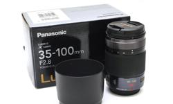 Excellent/mint condtion. Used for less than 300 images. Extremely sharp medium telephoto zoom for any 4/3 system. I used it with an Olympus Em-5. Includes box and packaging and carrying pouch - never used