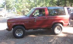 86 ford Bronco II 4x4 2.9 liter engine Auto transmission, power windows very clean interior, good glass, chrome wheels, Body rusty, Transmission Bad, no registration. Phone Don 250 248 3175 parting out or whole truck $ 500.00
