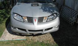 I have a 2003 pontiac sunfire that was written off so I am parting it out I have headlights signal lights radiator 2.2 litre ecotec motor and automatic transmission 124099km on the car runs great trans great also have drivers door (2 dr) drivers seat