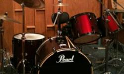 Hey there got a pearl drumset, red wine in colour. I bought all cymbals and a heavy duty throne with a back support. Cymbals are sabian and zildjen A and i bought a sabian b8 china. Interested email or text me. Number is 909 8895 This ad was posted with