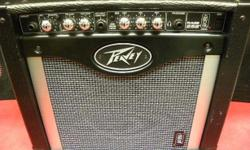 """Peavey 25W guitar amplifier with TransTube technology, model #RAGE 258, item #I-12805. 8"""" super-duty Blue Marvel speaker, 3-band EQ, 2 channels, tape/CD aux input/direct out, pre and post gain knobs, master volume, tack/Modern/Vintage voicing switch and"""