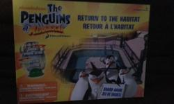 Penguins of Madagascar Return to the Habitat board game in excellent condition.