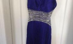 This floor-length silky gown is a lush periwinkle colour. It has attractive cutouts on the back outlined by delecate sequins. The dress is from Laura and is a size 0. I wore it once and am hoping someone else will also be able to feel beautiful in it.