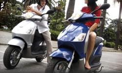 "Buy Now and Save Big on a Piaggio Fly 150cc 2010 graffics white, fully automatic motorscooter. Comes with one year free ""Road Canada"" road side assistance. Also Piaggio/Vespa vehicles include an international unlimited kilometer one year warranty. Top"