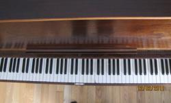 Upright piano. Good sounding, recently tuned. 54 inches wide.