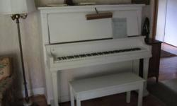 Full size upright. Fuller tone than apt.size pianos. Old but well-maintained and tuned. Painted off-white. Matching lift-top bench, and music-reading light included.