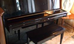 """Piano Young Chang Beautiful Black glossy piano 42"""" high and 57"""" wide 3 pedals. One Owner with original receipt from Ward music it has my address on it. I paid 2,944.44 in 1992. It has never been moved and has been maintained and sounds wonderful. It is in"""