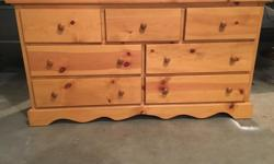 """Pine 7 drawer dresser, in great shape. Measures 57.5""""wide, 17.5""""deep, 30.5""""tall. Take a look at my other ads to view more pine furniture in the same finish for sale. Sorry, no delivery available."""