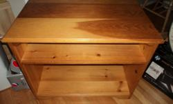 """For sale a PINE TV Stand.  Very sturdy and well made.   Dimensions:  31.5"""" Wide, 20"""" Deep and 25"""" High"""