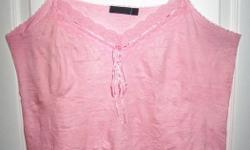 Versatile pink camisole with a special crushed effect look. Size 14, worn once. Pick up in downtown Ottawa (Bank/Queen/Kent/Albert area) or in Rockland.