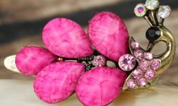 Beautiful pink peacock. new Swarowski crystals used. Not trademark.
