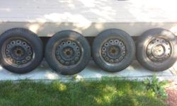 "Gently used Pirelli tires on 14"" rims. 4 tires in total. Less than 4000km. Only used last winter. Full tread and very good on ice and snow. Selling because no longer own the vehicle (Toyota Echo). Price is firm."