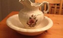 """This is a ceramic water pitcher and wash basin. The jug has a rose on it. The bowl is 16"""" across. They are both in excellent condition. Would have been used on a dry sink. Please email with any questions. Located near Big Bay and Yonge in the southeast"""