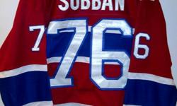 New with tags PK Subban #76 Montreal Canadiens Jersey size Large. Home colours with the Habs centennial patch on the shoulder. All names, numbers and logos are stitched on and not screened. Fight strap sewn on the inside.