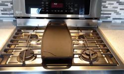 Plaque de cuisson jamais utilisée pour cuisinière au gaz modele LRG 3097. Valeur minimum de 110$ + taxes + livraison... http://www.lgcanadaparts.com/product/inv_9431768