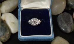 Platinum antique diamond ring.  Main diamond 1.45 ct. flanked by shoulders of single cut and baguette cut diamonds.  Asking below appraised value.  Appraisal included in sale of ring.