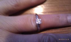 One stamped Platinum 950, ladys cast solitaire ring, simple curved shank to four claw setting. Width of shank measures 2.75mm and all high polish. Containing: One claw set Princess cut diamond, measuring 4.09 x 3.73 x 2.95mm approximate weight of .041 ct.