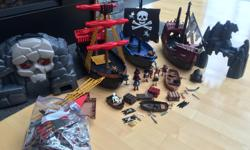 Tons of playmobil pirates stuff, includes 3 ships, tons of characters and accessories, a dock (in pieces in a bag) and more