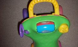 Baby stroll toy.  $10.  Folds down to turn into seat.  Has toys attached.   Call 519-466-5208 or reply to ad.