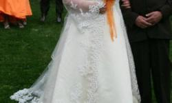 I have a beautiful plus size wedding dress..it is a size 24-26...The dress color is champagne and is satin..there is a jacket that goes over the whole dress that is a beautiful lace..it opens in the front and is long and makes the train in the back...it