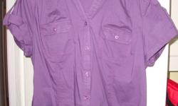 A women's short sleeve dark purple button up top in size large. Never been worn or washed. No tags. Comes from a smoke and pet free home. I can deliver to Pembroke. Contact through email. Please check out my other ads.
