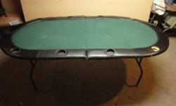 Poker Table-6ft Foldable. 72 L x 42 W x 29 in H. The table has a sturdy metal frame, folds in half with collapsible legs. the frame is in good shape. The playing surface is has been well used, the felt is in good shape except for one small burn mark, the