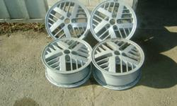 """SET OF FOUR 14"""" 5 BOLT ALUMINUM RIMS, CAME OF EARLY 90s PONTIAC, WILL FIT SUNFIRE, TEMPEST, GRAND AM, CAVALIER, & MORE, JUST BEEN PAINTED/ REFINISHED, CAN BE SEEN AT 341 DURHAM CT, OSHAWA, DAN. 905431-1808"""
