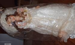 These dolls are all porcelain and have never been taken out of the boxes, only $25 each. Price is neogotiable.