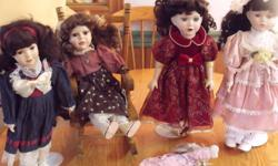 Porcelain Dolls. 4 Large dolls and 1 Small. 3 large dolls on stands 1 sits in a chair. No room to display them. $200.00 obo. Call Dave (705)422-2198