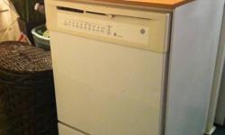 WHITE WITH OAK COUNTER TOP ENERGY STAR RATED QUIET POWER 1 4 YEARS OLD IN GOOD CONDITION WORKS GREAT!!! REASON FOR SELLING: Bought a house with a built-in dishwasher so no longer need this one