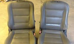 2 grey leather bucket seats. Driver side is power excellent condition This ad was posted with the Kijiji Classifieds app.