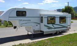 2003 28E33 Titanium 5th wheel for sale. Immaculate condition, barely used. Sleeps 8, bunkbeds, queen bedroom, pullout couch and table that converts to bed. Excellent family RV, too much to list.