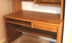 Three piece Oak finish office and cabinet storage suite. This is all you need for an attractive, high quality and space-efficient office suite in immaculate condition. Matching set consists of 3 pieces: 1. Desk with hutch and shelves 2. Printer stand with