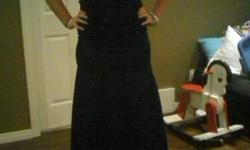 i have two fancy dress for sale - perfect for a formal, grad, wedding, etc. The pics aren't great but they were both worn only once! Perfect condition! The black gown is a size 8 from Laura's $75. The short dress also from Laura's is size 11 $50 OBO Just