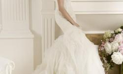 I'm selling my wedding dress, purchased in summer 2013. Find information below: Designer: Pronovia Style: Duende Condition: Used, cleaned Color: Ivory White Label size - 8 , fits size 6 (Street size) Congratulations on your engagement! Shopping for a
