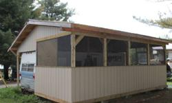Hello, I am selling a 5th wheelcamper with full steel roof, built only 2 years ago. Full 10 x 24 enclosed and screened area. Roof is constructed of 2 x 6 rafters and has OSB under 50 year painted steel (brown). Walls are made of Smart Board with a 35 year