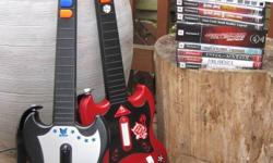 Playstation 2 Console complete with cables - Memory card included - 2 Controllers - 10 games (Guitar Hero- Aerosmith & Legends of Rock) Need for Speed-collectors addition and other assorted games) - 2 Guitar Hero guitars -Great for keeping at the cottage