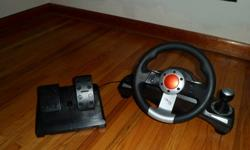 Steering wheel and foot pedals, works great just never use it wireless with receiver obo