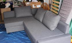 IKEA FRIHETEN COUCH in grey for sale. I am moving out west and I am selling my old furniture. I used this for one year, there are no spots or stains and it was in a smoke free and pet free house before hand.