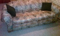 Pull out sofa bed with mattress.  Sofa is 80 inches wide and 36 inches deep.  Bed is 52 inches wide and 72 inches long.  Cushions included.  Pick up in East Kildonan.