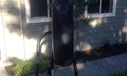 Punching bag and stand for sale.