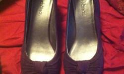 Women's size 7 1/2 dark purple suede heels. Looking for $20.00, contact Jodi at jodichatfield@live.com or at 780 289-7441. Made by Le Chateau, small heel.