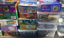 Large lot of puzzles and games. Over 30 puzzles ages 3 and up along with some board games. Will add others as I sort through other boxes. complete sets. Great idea to do a puzzle a day for less than 1$ a day. Includes: Cars, Toy Story, Melissa and Doug,