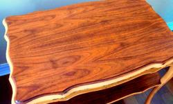 Lots of character featuring solid wood, curved legs, open lower shelf, unique, accent table beautifully refinished. It is in excellent condition. The top was sanded down to raw wood then multiple layers of Early American gel stain was applied to bring out