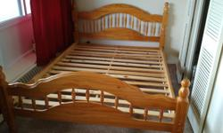 Solid wood (pine) queen bed frame with slats. Mattress not included.