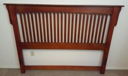 Selling wooden headboard, which fits a queen size bed. Real wood, and in great condition. Originally came with a slotted wooden bedframe, but have been using a standard metal bedframe (not included) with no issue. Hardware included. Headboard is a great