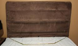 Queen Brown Microfiber Material over metal frame. Metal frame base goes under the mattress in between the mattress & boxspring. When material is pulled down it does not show the bars as in the picture. Text only