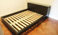 Black Malm Queen Size Platform Bed w/Headboard & Pull Out Shelves Both sides of the headboard conceal pull-out glass & wooden shelves for hidden storage. Top shelf is Tempered/safety glass. Includes a custom glass top for headboard. It is very easy to