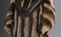 See the complete line on my web site.www.andrewdunn.us/Furs Size 14-16 Length 32 inches